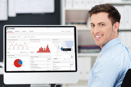 Geschäftsmann vor Monitor mit Statistiken